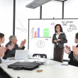 Businesswoman drawing a diagram during the presentation — Stockfoto
