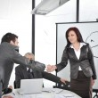 Hands shaking and making deal at office meeting — Stock Photo #10422063