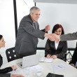 Successful business colleagues shaking hands with eachother at meeting — ストック写真