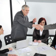 Successful business colleagues shaking hands with eachother at meeting — Stock fotografie