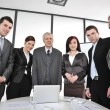 Foto Stock: Multi aged business standing around the table at office