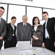 Group of business standing at office and smiling — Stockfoto
