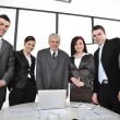 Group of business standing at office and smiling — Stock Photo