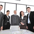 Group of business standing at office and smiling — Stock Photo #10422073