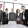 Royalty-Free Stock Photo: Group of business standing at office and smiling