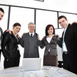 Group of business standing at office and holding each other — Stock Photo #10422074