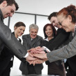Business partners hands on top of each other symbolizing companionship and unity — Foto de Stock