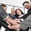 Group of executives placing their hands together — Stock Photo
