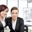 Royalty-Free Stock Photo: Portrait of two businesswomen in business presentation at office