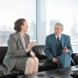 Two colleagues having a break during business meeting with cigarette — Stock Photo