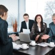 Businesswoman in an interview with three business getting bad results — Stock Photo