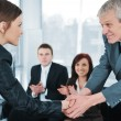 Stock Photo: Young business woman passed on a job interview shaking hands with boss