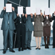 Successful business team standing holding white papers — Stock Photo