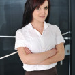 Young pretty businesswoman posing with her arms folded — Stock Photo