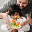 Levitating burger in air made by father and son - Stock Photo