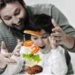Stock Photo: Retro photo of dad and son making hamburger