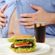 Fat stomach with burger and cola — Stock Photo #10422394