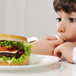 Little boy and burger — Stock Photo