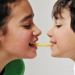 Sister and brother eating french fries — Stock Photo
