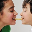 Sister and brother eating french fries — Stock Photo #10422407