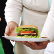Burger ready for children by Mom — Stock Photo