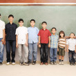 Children at school classroom — Stock Photo #10422477