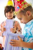 Cute kid receiving birthday present box — Stock Photo