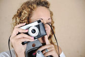 Blonde girl with retro camera — Stock Photo