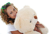 Teenage girl holding a teddy bear (no name or trademark) — Stock Photo