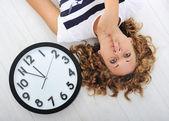 Girl and clock silence secret — Stock Photo