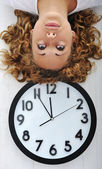 Girl and clock upside down — Stock Photo