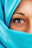 Young woman with blue scarf — Stock Photo
