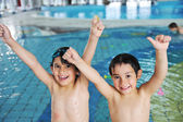 Two kids at pool — Stock Photo