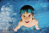 Little cute boy at pool — Stock Photo
