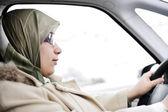 Muslim Arabic woman driving car — Stock Photo