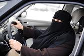 Arabic Muslim woman driving a car — Stock Photo