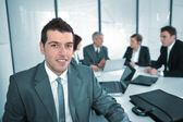 Portrait of a successful businessman and business team at meeting — Stock Photo