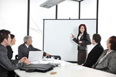Business meeting - group of in office at presentation — Foto Stock