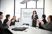 Business woman making the presentation and receiving applause — Stok fotoğraf