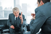 Business talking while boss is finger pointing — Stock Photo