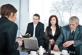Businesswoman in an interview with three business — Stock Photo