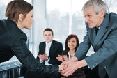 Young business woman passed on a job interview shaking hands with boss — Stock Photo
