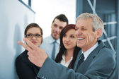 Boss explaining graph to his team — Stock Photo