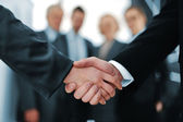 Handshake in front of business — Stock fotografie