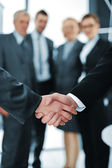 Handshake isolated on business background — Fotografia Stock