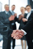 Succesful handshake with business aplauding — Stock Photo