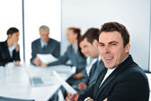 Team of young professionals working on new business project at a meeting — Stock Photo