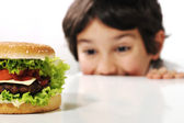 Kid and hamburger — Stock Photo