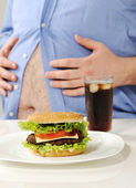 Fat stomach with burger and cola — Stock Photo
