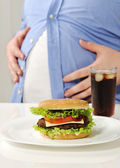 Fat man with hamburger and cola — Stock Photo